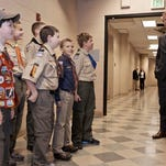 Peyton Manning talks to a group of scouts before he spoke to the Boy Scouts of America's annual breakfast Wednesday in Denver.
