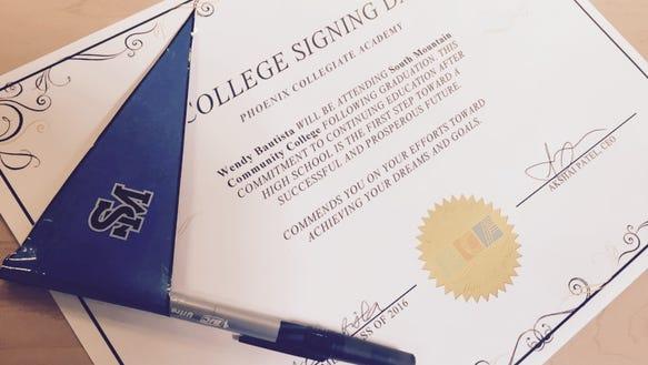 The seniors at Phoenix Collegiate Academy each signed