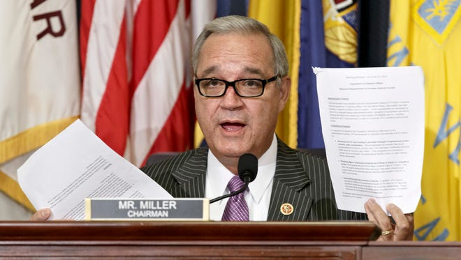 House Veterans Affairs Committee Chairman Jeff Miller, R-Fla., holds up two pages of resource requests from the Department of Veterans Affairs on Capitol Hill in Washington. The chairmen of the House and Senate Veterans Affairs committees have reached a tentative agreement on a plan to fix a veterans' health program scandalized by long patient wait times and falsified records covering up delays. Rep. Jeff Miller, R-Fla., and Sanders scheduled a news conference Monday, July 28, to talk about a compromise plan to improve veterans' care.
