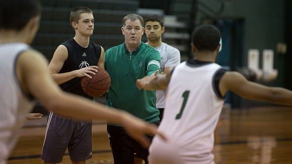 First-year Christ School basketball coach Scott Willard and the Greenies are 13-6 after Monday's win over Forsyth Country Day.