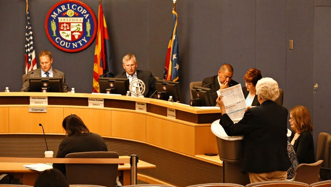 County Elections Director Karen Osborne (right) addresses the Maricopa County Board of Supervisors on April 20, 2016, about the increase in polling places for a May 17 special election.