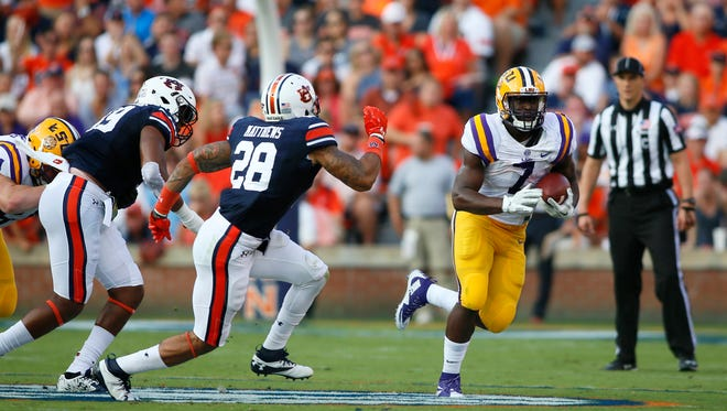 LSU Tigers running back Leonard Fournette (7) carries against the Auburn Tigers during the first quarter at Jordan Hare Stadium.