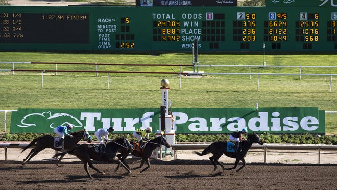 Infighting between the Simms brothers threatens the reputation and future of Turf Paradise. Here, jockey Erick Lopez (right) wins the 5th Race riding Evening Concerto on Feb. 1, 2017.