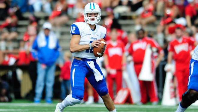Middle Tennessee quarterback Brent Stockstill (12) has a long relationship with Louisiana Tech coach Skip Holtz that dates back 20 years.
