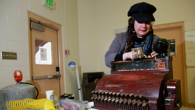 Cindy Iacovetto works on her steam-powered desk on Feb. 6 at the Aztec Senior-Community Center. Iacovetto is the organizer of this weekend's Steamers & Dreamers steampunk convention in Aztec.