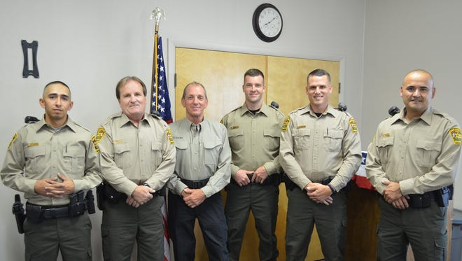 """From left, Anthony D. Sanchez, Jeff S. Manning, Dan Geremia, David V. Willcox, Dustin R. Maxwell and Zack Hunt pose for a photo after graduating as reserve deputies from the San Juan County Sheriff's Office. The Sheriff's Office recognized the six men during a graduation ceremony on Aug. 24 at the Fraternal Order of Police building in Farmington. Volunteers must complete 178 hours of law enforcement training to become reserve deputies. Applications are being accepted now for the upcoming academy. Volunteers can apply by clicking the """"Jobs"""" link on the San Juan County website, sjcounty.net. For more information, contact Jayme Harcrow at 505-334-7027."""