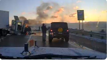 Frame grab from a video of an MSP trooper saving a man from a burning car on on Ann Arbor Road over Interstate 275 in Wayne County Tuesday, Nov. 17, 2020.