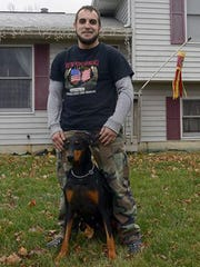 Eric Calley with his service dog, Sun, outside their