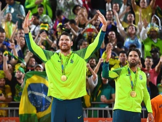 Brazil's Alison Cerutti and Bruno Oscar Schmidt celebrate