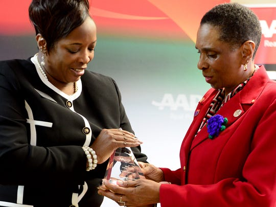 AARP Tennessee Representitive Andrea Neely presents the annual Andrus Award to Carolyn Lawhorn in recognition of her outstanding service to the community Wednesday morning.