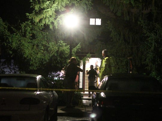 Authorities on Sept. 22, 2013, investigate the Fox Point condo building of Joseph and Olga Connell, who were killed outside the building.