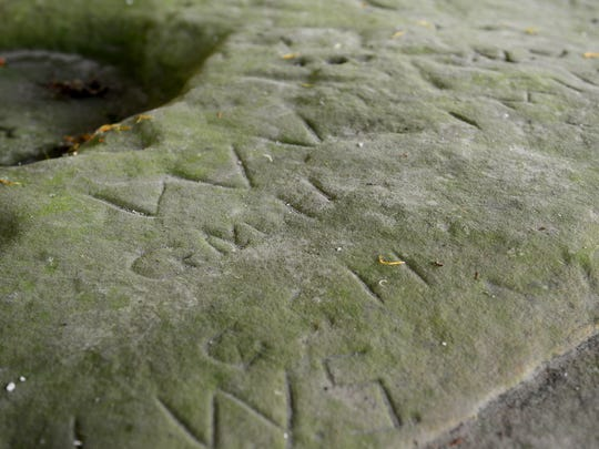 Through time passersby, including many loggers, have carved their initials into the sandstone at the Sanilac Petroglyphs Historic State Park near Cass City.