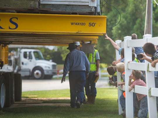 Dozens of people gathered to watch Wolfe House & Building Movers move a late 1700s home a quarter mile in Millcreek Township on Wednesday, Aug. 31, 2016.