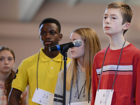 Annalise Wade, Ikenna Oleru, and Jayden Conn awaite their turn as Noah Brandt spells a word out during the 2017 West Tennessee Regional Spelling Bee on Saturday morning.