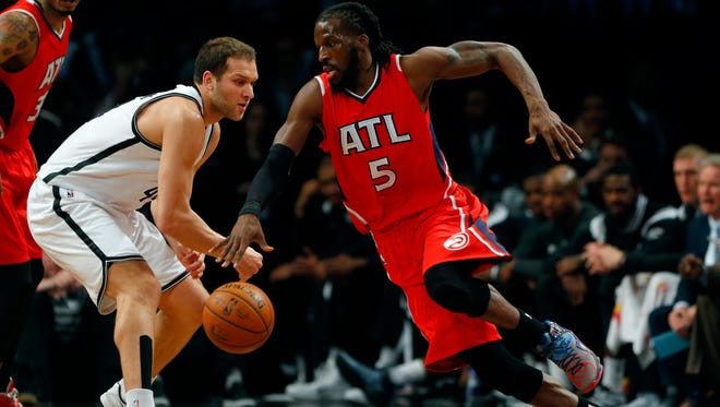Atlanta Hawks forward DeMarre Carroll (5) dribbles around Brooklyn Nets guard Bojan Bogdanovic (44) during a game at Barclays Center.