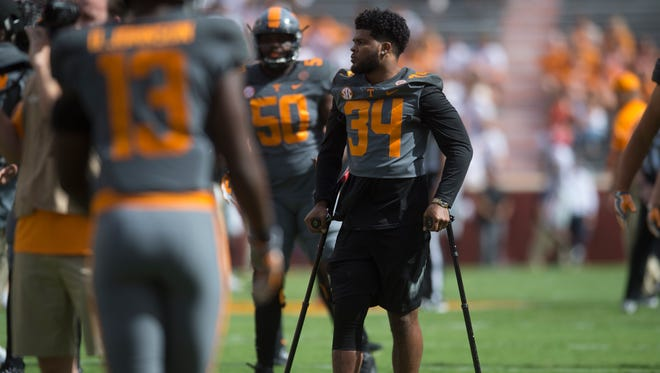 Tennessee linebacker Darrin Kirkland Jr. (34) watches the team warm up during the Tennessee Volunteers vs. Georgia Bulldogs game at Neyland Stadium in Knoxville, Tennessee on Saturday, September 30, 2017.