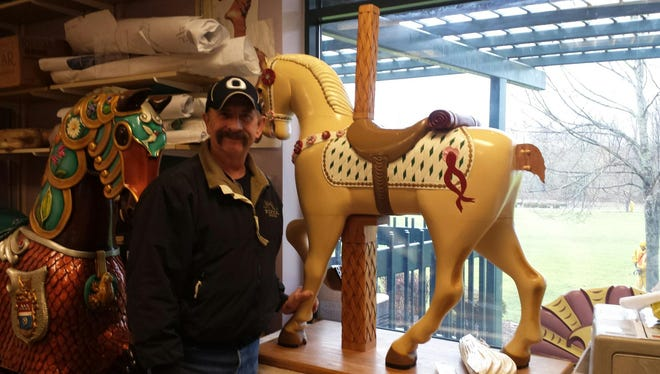 Dave Walery with the hand-carved carousel horse that has been on display at Walery's Premium Pizza for years. It was damaged during an early-morning attempted burglary on Thursday, Feb. 16, 2017.