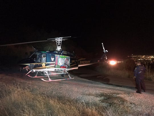 A helicopter, search-and-rescue team and several firefighting