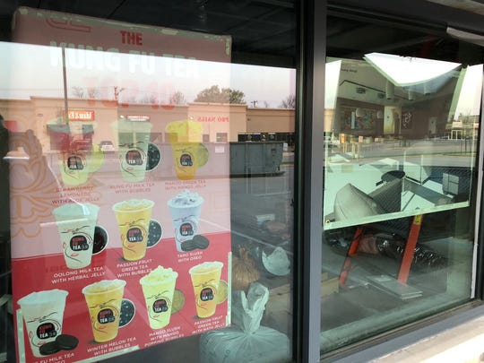 The top 10 most popular drinks, seen in the window of Kung Fu Tea, a bubble tea drink shop set to open this month.