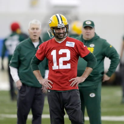 Green Bay Packers quarterback Aaron Rodgers (12) watches