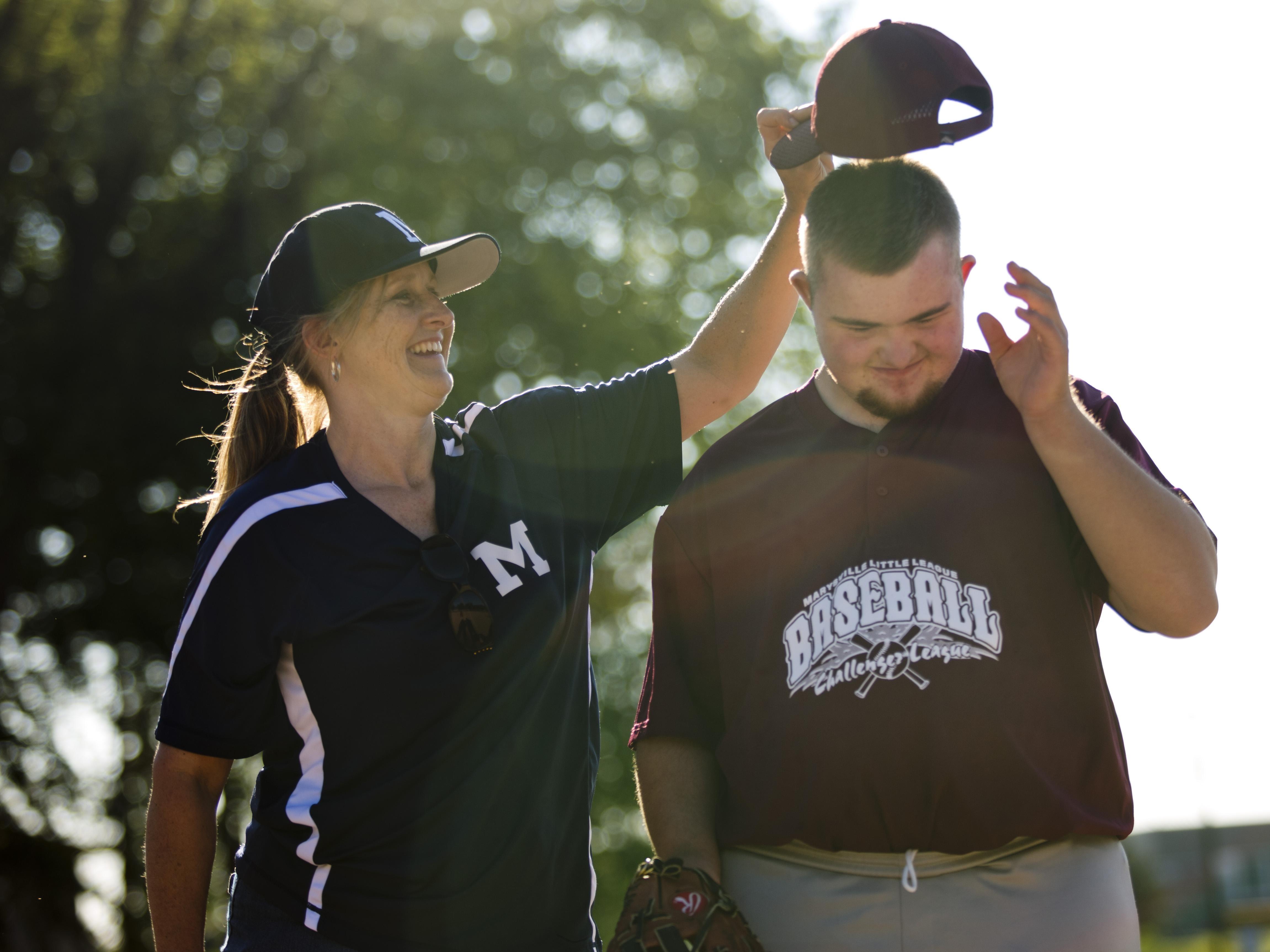 Cheri Weingartz, of Smith's Creek, jokes around with her son Jacob Weingartz during a Marysville Little League Challenger Division baseball game Thursday, July 2, 2015 at Marysville Municipal Park.