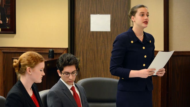 Ray High School students Julie Graves (from left), Carlos Carroll, and Daya Butler compete as lawyers during the Region 2 high school mock trial competition Saturday, Feb. 4, 2017, at the Nueces County Courthouse. The Ray team won, which means they go to Dallas for the state competition.