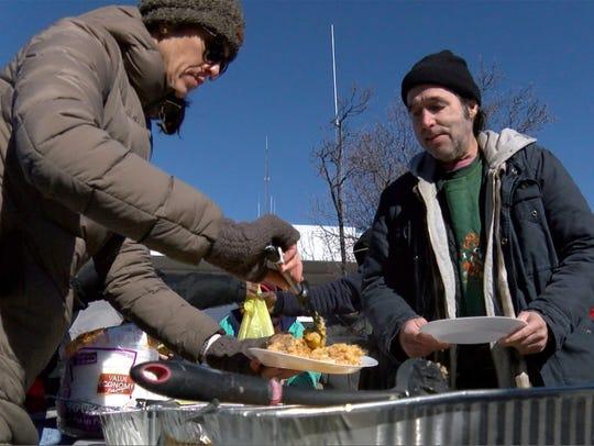 Volunteer Tia Ditullio, Point Pleasant Borough, dishes