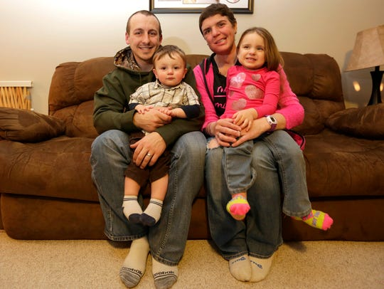 Nathan Zuelke with his wife, Lindsay, and their two