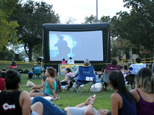 Movie fans of all ages gather Saturday, July 16, 2016, at Young Park to watch free movies sponsored by the city of Las Cruces Parks & Recreation department.  The movies are shown every Saturday during the summer.