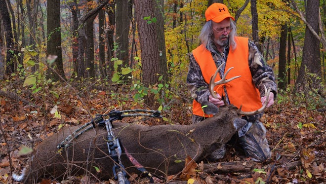 The author is pictured with a nice buck he took down a couple of years ago.
