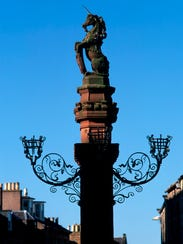 Looking Over To The Mercat Cross, Framed Against A