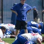 Giants coach Tom Coughlin looks on as the team stretches during practice at the team's NFL football rookie minicamp Friday.