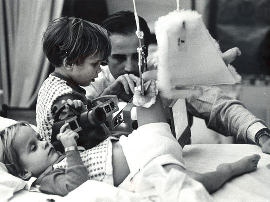 Joe Biden visits with his sons, Beau (lying) and Hunter in their Delaware hospital room. Days before Biden lost his wife, Neilia, and baby daughter, Naomi, in a car crash that left his sons badly injured. Dec. 27, 1972