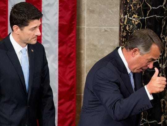 Outgoing speaker John Boehner gives a thumbs-up as