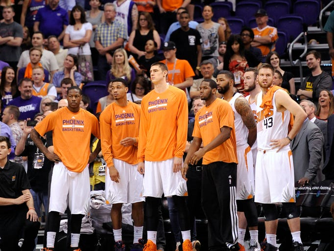 Suns players look on late in the game against the Memphis Grizzlies on April 14, 2014, at US Airways Center. The Grizzlies won 97-91, eliminating the Suns from playoff contention.