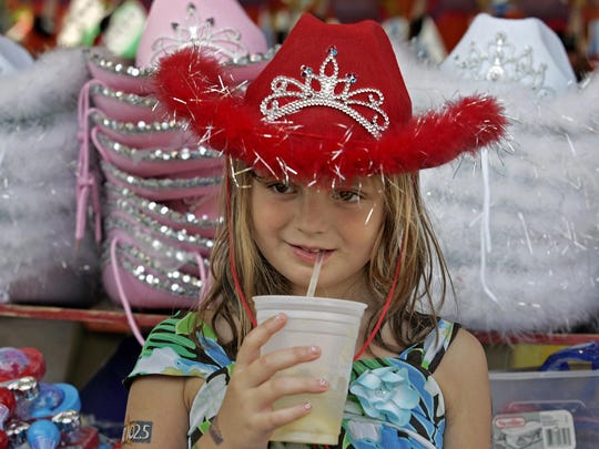 Wearing her brand new red cowgirl hat, Kara Darr, of
