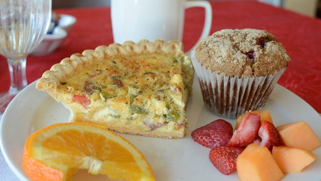 The Mustard Seed Cafe in Bellevue features rotating specialties like this quiche with shrimp, andouille sausage, green peppers and tomatoes with a side of fruit.
