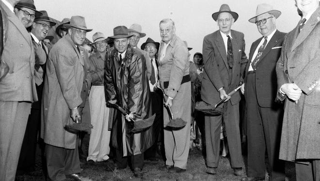 Four Springfieldians lift the first shovels of dirt, formally breaking ground for the Fellows Lake Dam. Holding the shovels from left to right are Jasper W. Everett, Attorney John K. Hulston, H. Frank Fellows, and Mayor W. L. English. Contractor M. E. Gillioz is to the right of English.