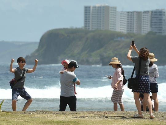 Tourists visiting the island from Korea enjoy the picturesque