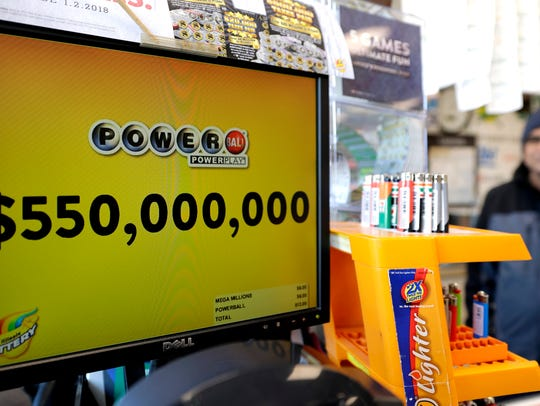 A Powerball lottery sign displays the lottery prizes