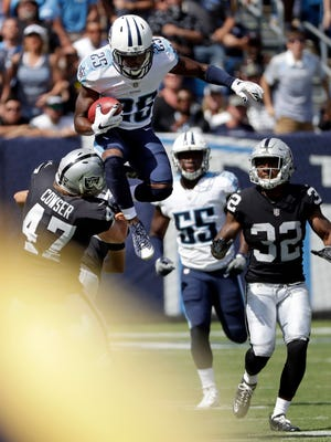 Tennessee Titans' Adoree' Jackson (25) leaps over Oakland Raiders defenders as Jackson returns a kickoff in the second half of an NFL football game Sunday, Sept. 10, 2017, in Nashville, Tenn.
