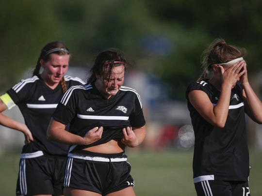 Members of the Ankeny Centennial girls' soccer team show their emotions following a 1-0 loss to Valley in the Class 3A semifinals of the state tournament on Friday at Cownie Soccer Park. From left are seniors Adrie Gunn, Emily Fontana and Abby Yaske.