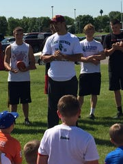 NFL wide receiver and Rocori graduate Eric Decker speaks to participants at his football camp last summer at Rocori High School.