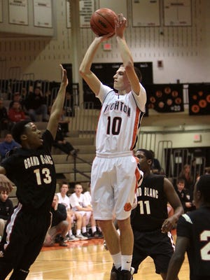 Dylan Bennett scored a game-high 27 points to help Brighton beat Grand Blanc, 61-56, for the first time since 2011 on Tuesday night.