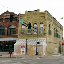 In 1872, German immigrant Berhard Vossberg hired local architect Allen E. Hussey to build a brick structure at St. Germain and Eighth Avenue. It is shown Tuesday, Feb. 2, as remodeling continued in preparation for the opening of JL Beers.