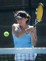 Nicolet No. 1 doubles player Elise Gerard returns a shot against Neenah in the Nicolet Invitational girls tennis tournament Saturday.