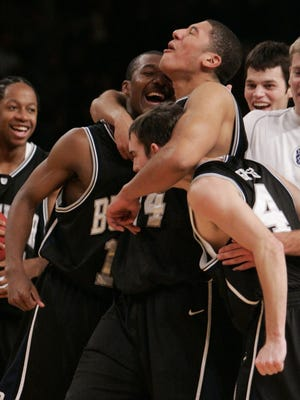 Brian Ligon, center, celebrates with Mike Green, left, and A.J. Graves after Butler defeated Gonzaga 79-71 for the NIT Season Tip-Off championship on Nov. 24, 2006 at Madison Square Garden in New York. (AP Photo/Julie Jacobson)