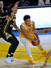 University of Wisconsin-Milwaukee forward Bryce Nze drives against Western Michigan forward Brandon Johnson.