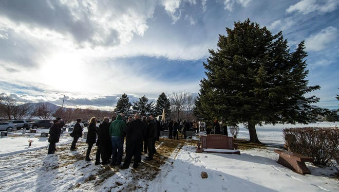 Family and friends gather during funeral services for Rashaan Salaam in December.