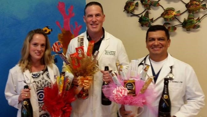 Nurse practitioners Whitney Stacy (from left), Dr. Mark Reinhardt and Luis Cardenas celebrated Texas Nurse Practitioner Week at Bay Area Quick Care.